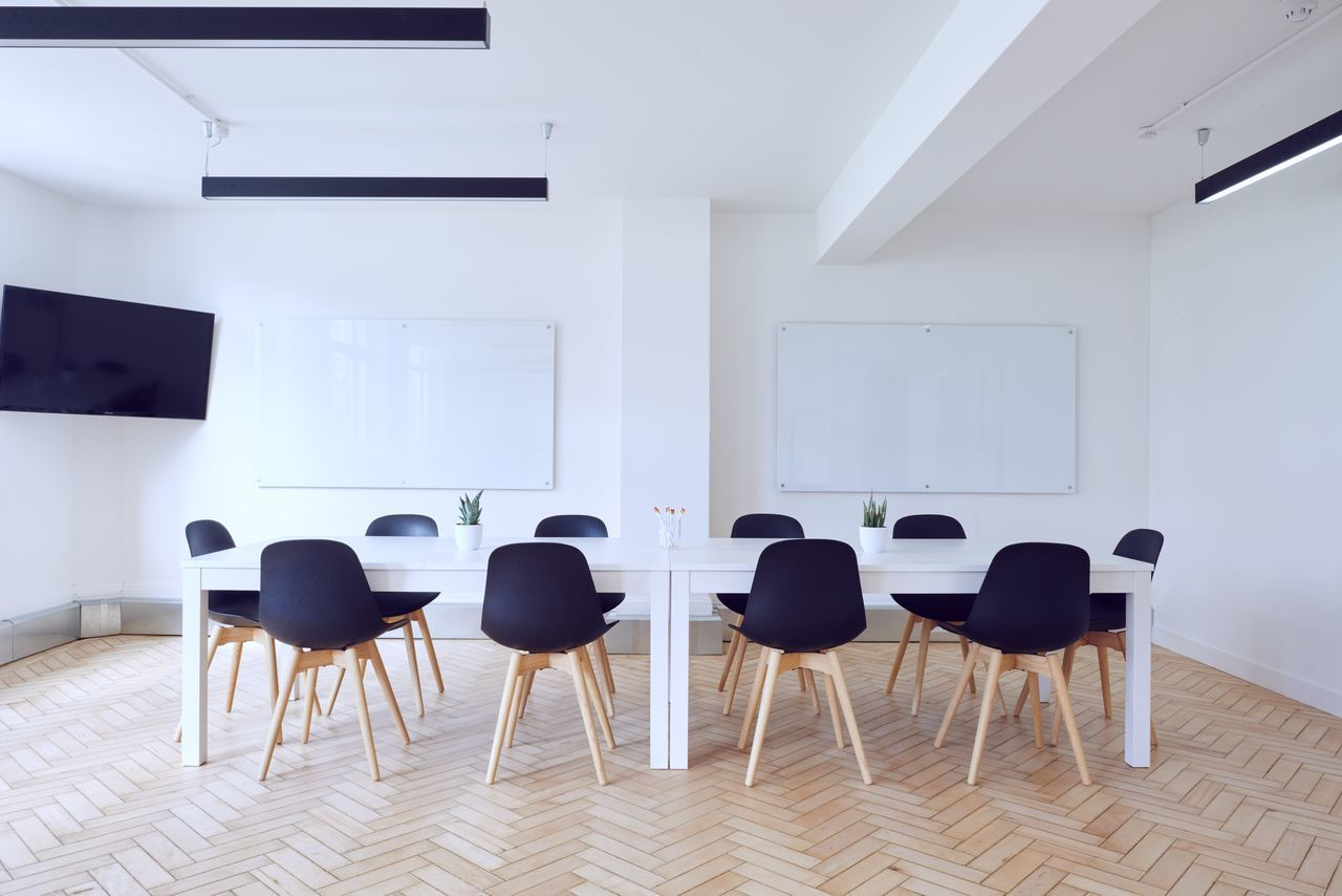 Empty office space with table and chairs