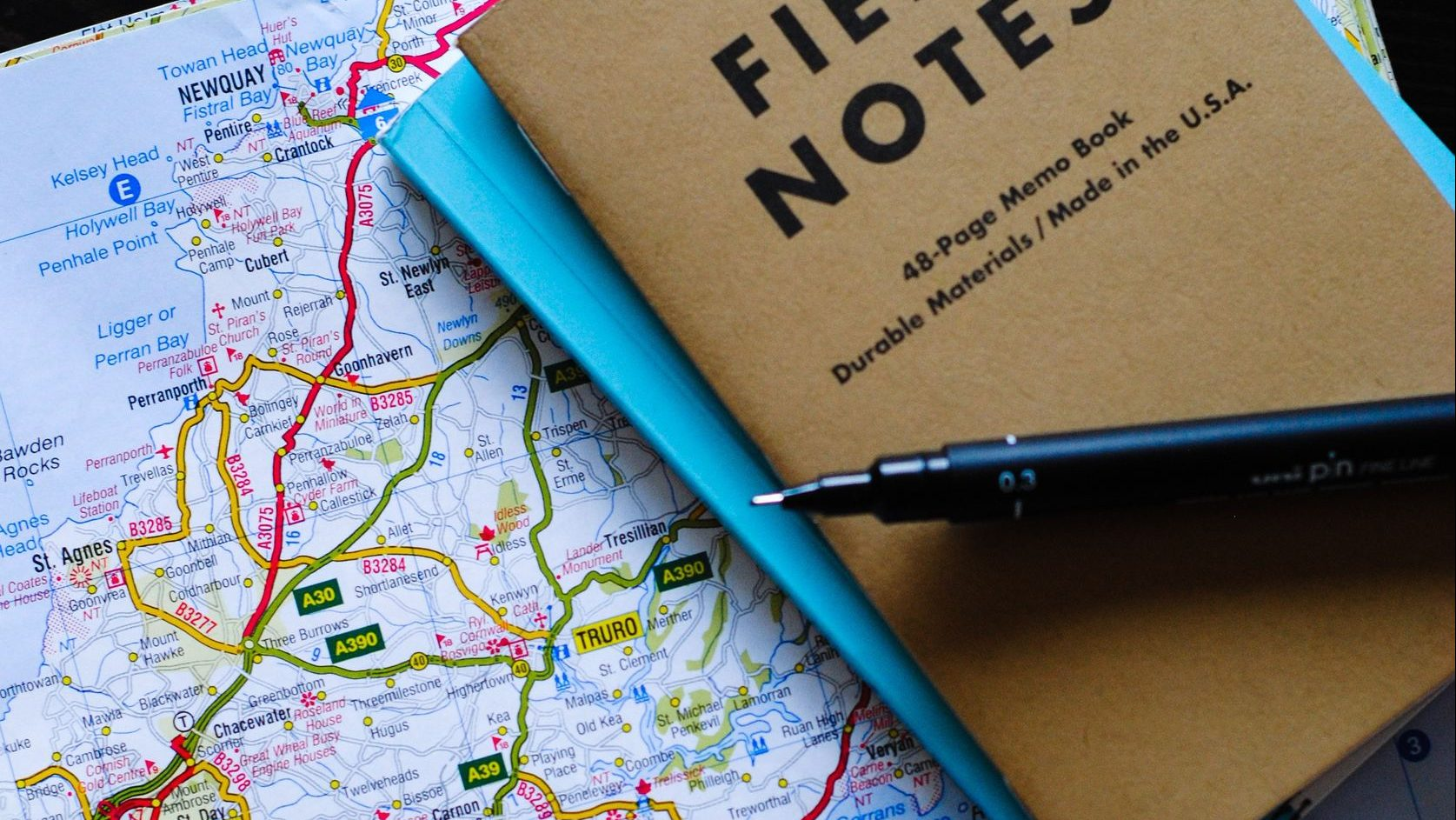 Picture of a map with a notepad