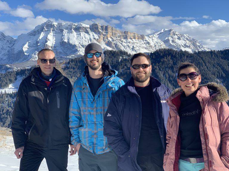 Highrise Digital team with a view of the Dolomites behind them
